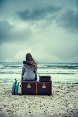 Magdalena Russocka girl on wintry beach with suitcases Women