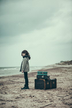 Magdalena Russocka young girl on beach with suitcases Women