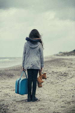Magdalena Russocka young girl on beach with suitcase and teddy bear Women