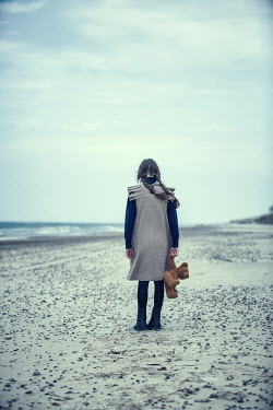 Magdalena Russocka young girl holding teddy on beach Women