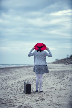 Magdalena Russocka young girl with red hat on beach Women