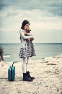 Magdalena Russocka young girl hugging teddy by sea Women