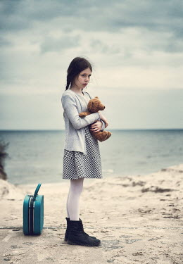 Magdalena Russocka little girl hugging teddy by sea Women