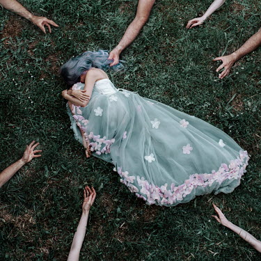 Jovana Rikalo WOMAN LYING IN GOWN SURROUNDED BY HANDS Women