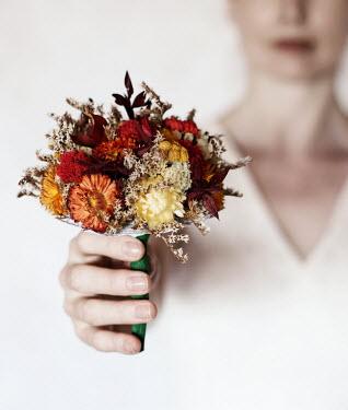 Manuela Deigert WOMAN HOLDING POSY OF DRIED FLOWERS Women