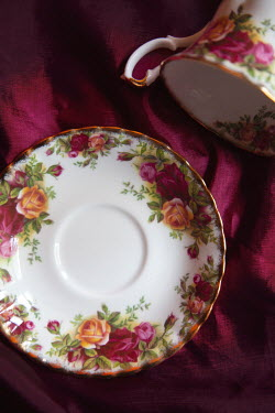 Miguel Sobreira CLOSE UP OF FLORAL CUP AND SAUCER Miscellaneous Objects