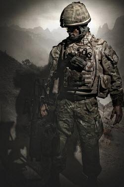 Nik Keevil MODERN SOLDIER AT DUSK WITH MOUNTAINS Men