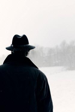 Ilona Wellmann MAN IN HAT IN SNOWY COUNTRYSIDE Men