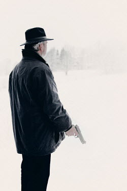 Ilona Wellmann MAN WITH GUN IN SNOWY COUNTRYSIDE Men
