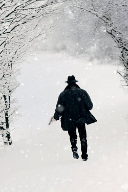 Ilona Wellmann MAN RUNNING WITH GUN IN SNOWY COUNTRYSIDE Men