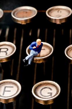 Valentino Sani MINIATURE MODEL MAN ON TYPEWRITER KEYS Miscellaneous Objects