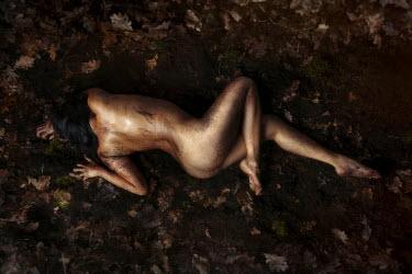 Eva Van Oosten NAKED WOMAN LYING ON LEAVES Women
