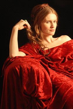 Michael Trevillion WOMAN WITH RED HAIR DRAPED IN RED VELVET Women