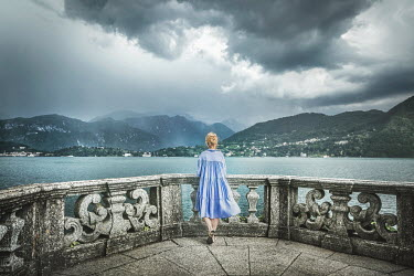 Evelina Kremsdorf GIRL ON TERRACE BY STORMY LAKE Women