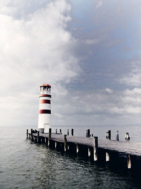 Ilona Wellmann LIGHTHOUSE ON JETTY BY SEA Miscellaneous Buildings