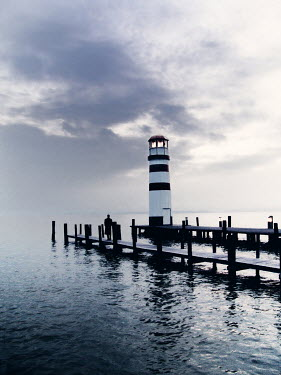 Ilona Wellmann MAN ON JETTY BY LIGHTHOUSE Men
