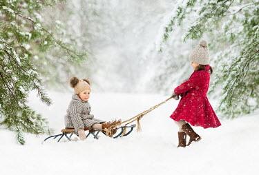 Lilia Alvarado TWO CHILDREN PLAYING WITH SLEIGH IN SNOW Children