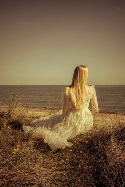 Nic Skerten YOUNG BLONDE WOMAN LOOKING OUT TO SEA Women