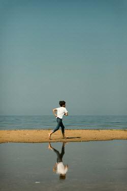 Krasimira Petrova Shishkova BOY RUNNING ON SUMMERY BEACH Children