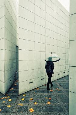 Eric Forey WOMAN WALKING HOLDING UMBRELLA Women