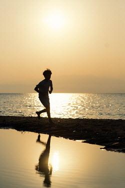 Krasimira Petrova Shishkova SILHOUETTED BOY RUNNING ON SUMMERY BEACH Children