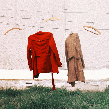 Oana Stoian TWO COATS HANGING ON LINE OUTDOORS Miscellaneous Objects