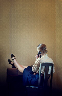 Mary Wethey WOMAN WITH FEET UP ON TELEPHONE Women
