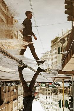 Giovan Battista D'Achille REFLECTION OF MAN WALKING IN CITY Men