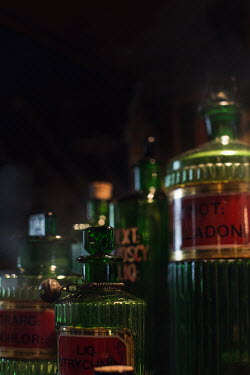 Holly Leedham CLOSE UP OF GREEN BOTTLES Miscellaneous Objects