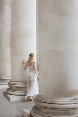 Holly Leedham WOMAN IN WHITE BY LARGE PILLARS Women