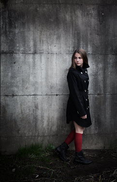 Robin Macmillan TEENAGE GIRL IN COAT BY WALL Children