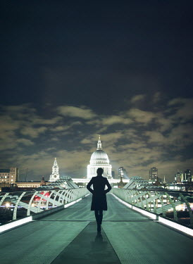 Mark Owen WOMAN ON BRIDGE IN LONDON AT NIGHT Women