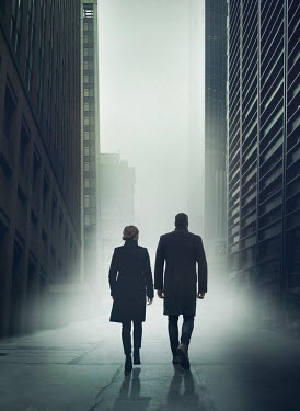Mark Owen SILHOUETTED COUPLE WALKING IN MODERN CITY Couples