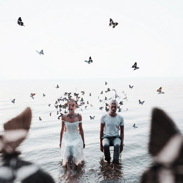 Jovana Rikalo WOMAN AND MAN SITTING IN WATER WITH BUTTERFLY ORNAMENT Couples