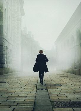 Mark Owen WOMAN RUNNING IN EMPTY OLD STREET Women