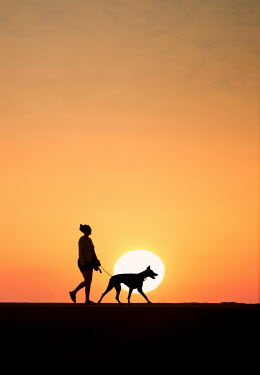 Terry Bidgood SILHOUETTE OF GIRL AND DOG AT SUNSET Women