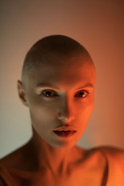 Marta Bevacqua WOMAN WITH SHAVEN HEAD IN RED LIGHT Women