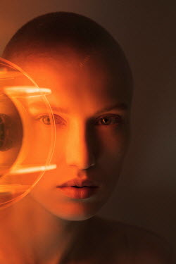 Marta Bevacqua CLOSE UP OF WOMAN WITH ORANGE LIGHT Women