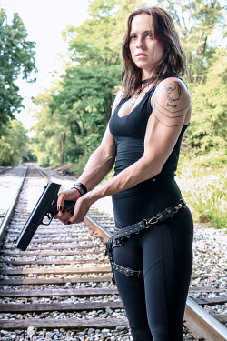 Stephen Carroll MODERN GIRL WITH GUN ON RAILWAY TRACKS Women