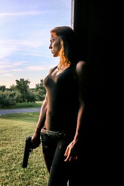 Stephen Carroll WOMAN WITH GUN IN COUNTRYSIDE Women
