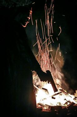 Stephen Carroll MAN WITH GUN BY FIRE AT NIGHT Men