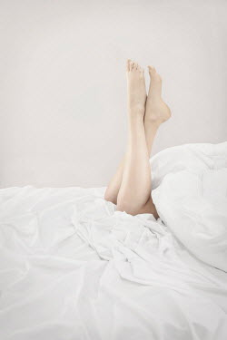 Emma Goulder CLOSE UP OF FEMALE LEGS IN BED Women