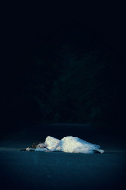 Magdalena Russocka WOMAN IN WHITE LYING ON ROAD AT NIGHT Women