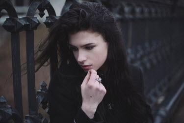 Anna Rakhvalova SAD BRUNETTE GIRL BY RAILINGS Women
