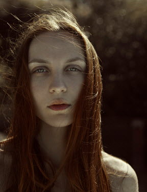 Marta Bevacqua SERIOUS WOMAN WITH RED HAIR OUTDOORS Women