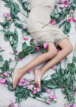 Jovana Rikalo WOMAN LYING BAREFOOT WITH FLOWERS Women