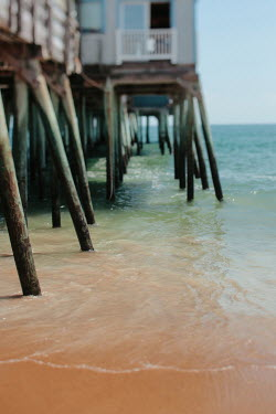 Alicia Bock CLOSE UP OF STILTS OF PIER Miscellaneous Buildings