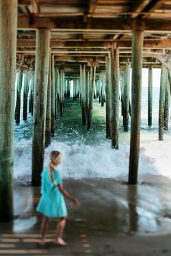 Alicia Bock GIRL UNDERNEATH PIER WATCHING WAVE Children