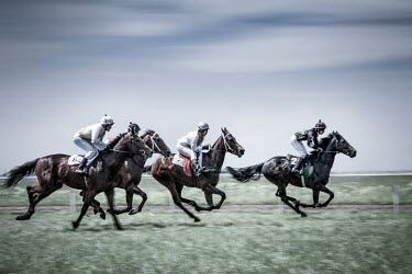 Evelina Kremsdorf JOCKEYS RIDING HORSES IN RACE Groups/Crowds