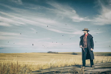 Evelina Kremsdorf COWBOY WATCHING FIELDS WITH BIRDS Men